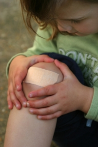 Girl with scraped knee
